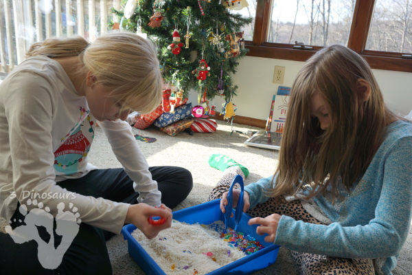 Christmas Lights & Rice Sensory Bin - simple and easy to set up sensor bin for kids to play in and great for sensory play - 3Dinosaurs.com