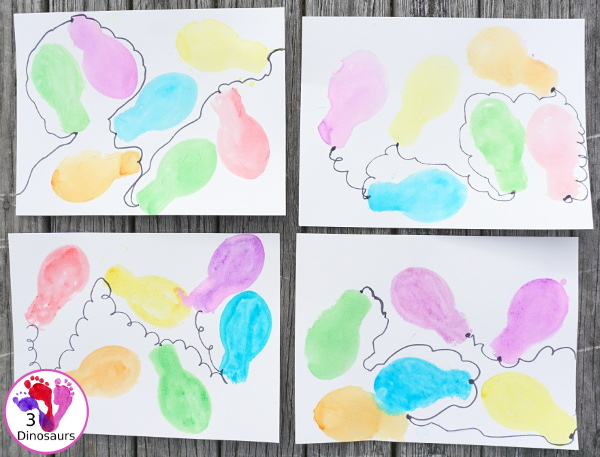 Easy to do Glitter Watercolor Christmas Lights Painting - using glitter watercolors and cookie cutters is easy to have different ages work together on a fun painting activity - 3Dinosaurs.com