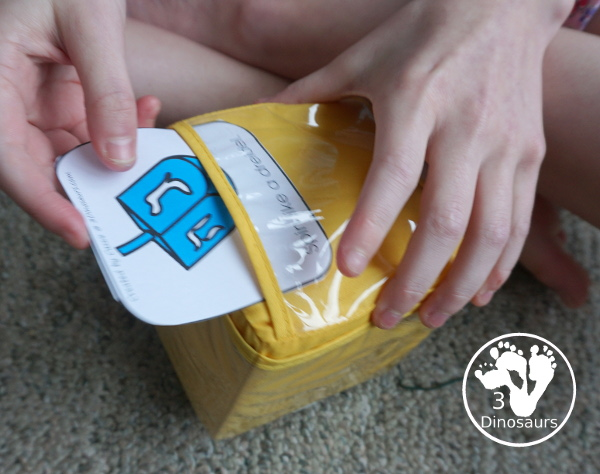 Free Hanukkah Gross Motor Dice - to get kids moving and have fun with easy gross motor movements and fun way to remember parts of the Hanukkah - 3Dinosaurs.com