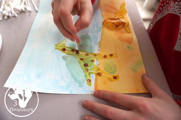 Giraffe & Lion Painting with Lions at Lunchtime - a fun watercolor and cookie cutter painting activity to make an African animal scene - 3Dinosaurs.com