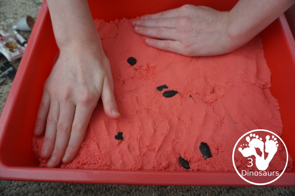 Mars Themed Sensory Bin with kinetic sand - a fun way to explore the red planet Mars -  3Dinosaurs.com