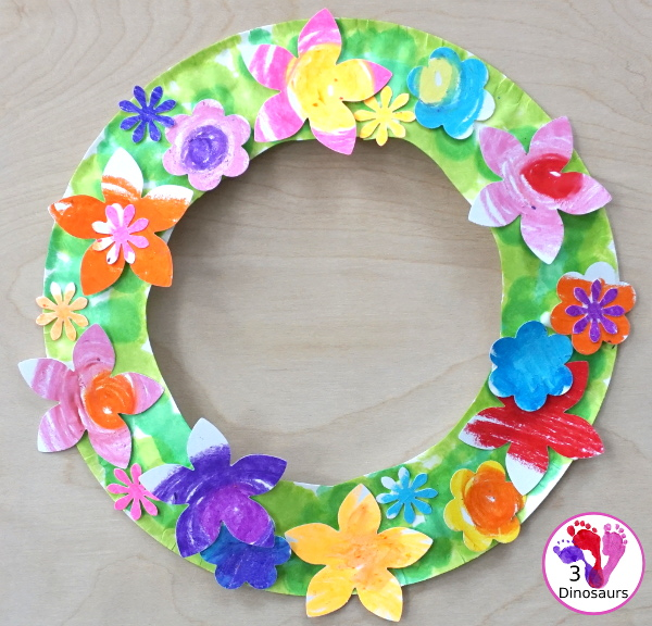 Flower Themed Paper Plate Wreath: Oil Pastels - fun and easy wreaths to make at any time using flower punches and paper plates - 3Dinosaurs.com