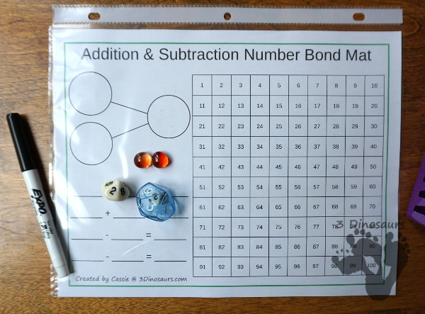 Free Addition & Subtraction Number Bond Mats with 100 Chart - with several color options and has math facts, number bonds and 100 chart for kids to use - 3Dinosaurs.com
