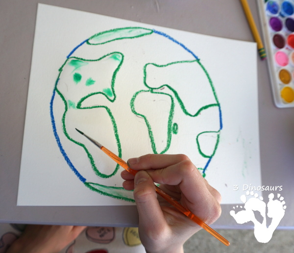 Watercolor Planet Earth Process Art - An easy and fun art project for planet Earth using watercolors and oil pastels - 3Dinosaurs.com