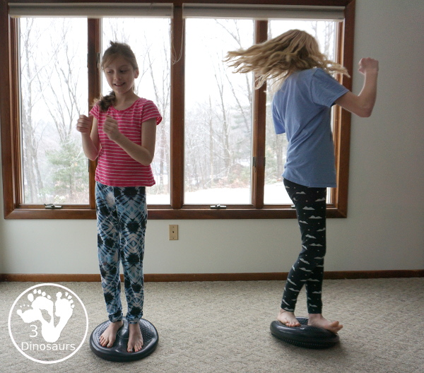 Gross Motor: Balance Cushion Activities - 4 fun movements that can be done indoors and get the wiggles out and work on balance and core strenght at the same time. - 3Dinosaurs.com