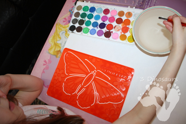 Watercolor Bugs with Stencils - a fun fine motor painting activity for kids to do - 3Dinosaurs.com
