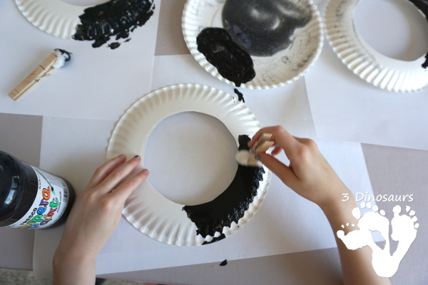 A Fun Space Theme Wreath - make a paper plate wreath with a space theme that has planets and stars - 3Dinosaurs.com