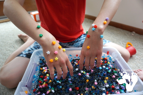 Star Themed Water Bead Sensory Bin - simple to make and play in with loads of space-themed fun for kids  - 3Dinosaurs.com