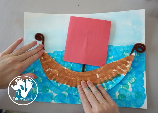 Easy to Make Viking Ship with Viking Ships at Sunrise - with a paper plate, dot markers, and watercolors to make this fun craft of a Viking Ship for the Magic Tree House Book- 3Dinosaurs.com
